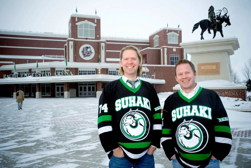 """Suhaki, the name Steve Ekman (left) and Hans Halvorson proudly wear on their jerseys, is a bit of wordplay pronounced like """"Sioux hockey."""" They are among University of North Dakota alumni and fans trying to save the UND nickname Fighting Sioux. (Associated Press)"""