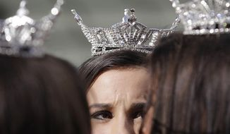 "** FILE ** Miss America contestants wait for the start of the ""Show Us Your Shoes"" parade on Friday, Jan. 14, 2011, in Las Vegas. (AP Photo/Julie Jacobson)"