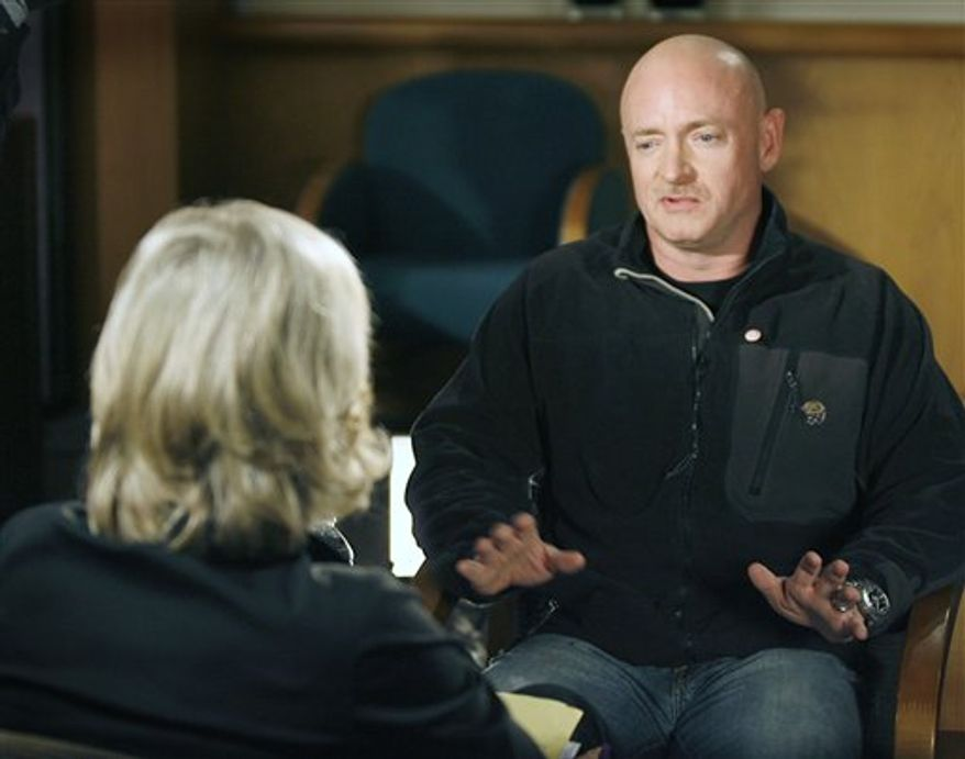 This photo provided by ABC television shows Rep. Gabrielle Giffords' husband and NASA astronaut Capt. Mark Kelly talks with host Diane Sawyer during a pretaped interview in Tucson, Saturday, Jan. 15, 2011, his first television interview since the tragic shooting of his wife in Tucson. The interview is scheduled to air Tuesday, Jan. 18. (AP Photo/ABC News, Ralph Freso)  NO ARCHIVES. NO SALES.