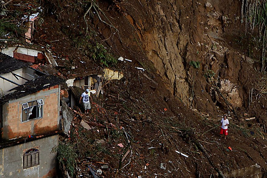 Residents search for landslide victims in Nova Friburgo, Brazil, Monday, Jan. 17, 2011. (AP Photo/Felipe Dana)