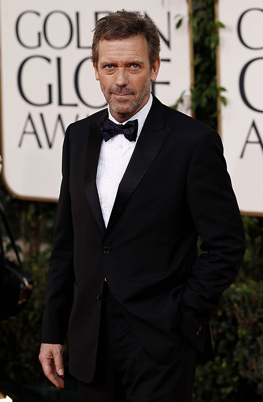 Hugh Laurie arrives for the Golden Globe Awards Sunday, Jan. 16, 2011, in Beverly Hills, Calif. (AP Photo/Matt Sayles)