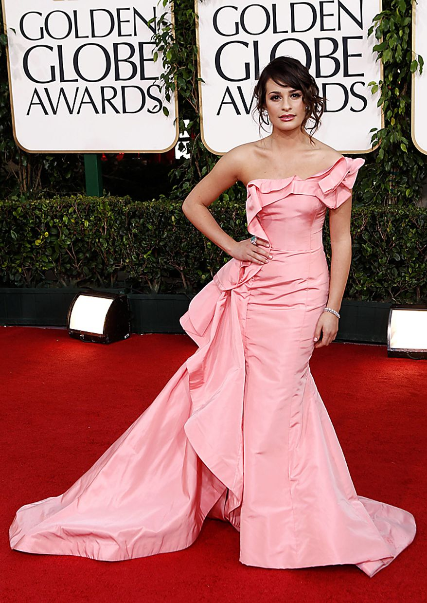 Actress Lea Michele arrives at the Golden Globe Awards Sunday, Jan. 16, 2011, in Beverly Hills, Calif. (AP Photo/Matt Sayles)