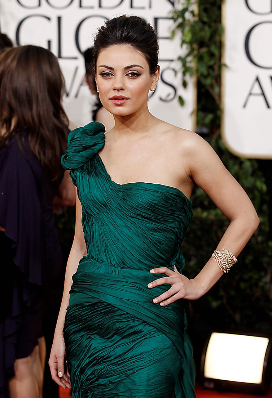 Mila Kunis arrives at the Golden Globe Awards Sunday, Jan. 16, 2011, in Beverly Hills, Calif. (AP Photo/Matt Sayles)