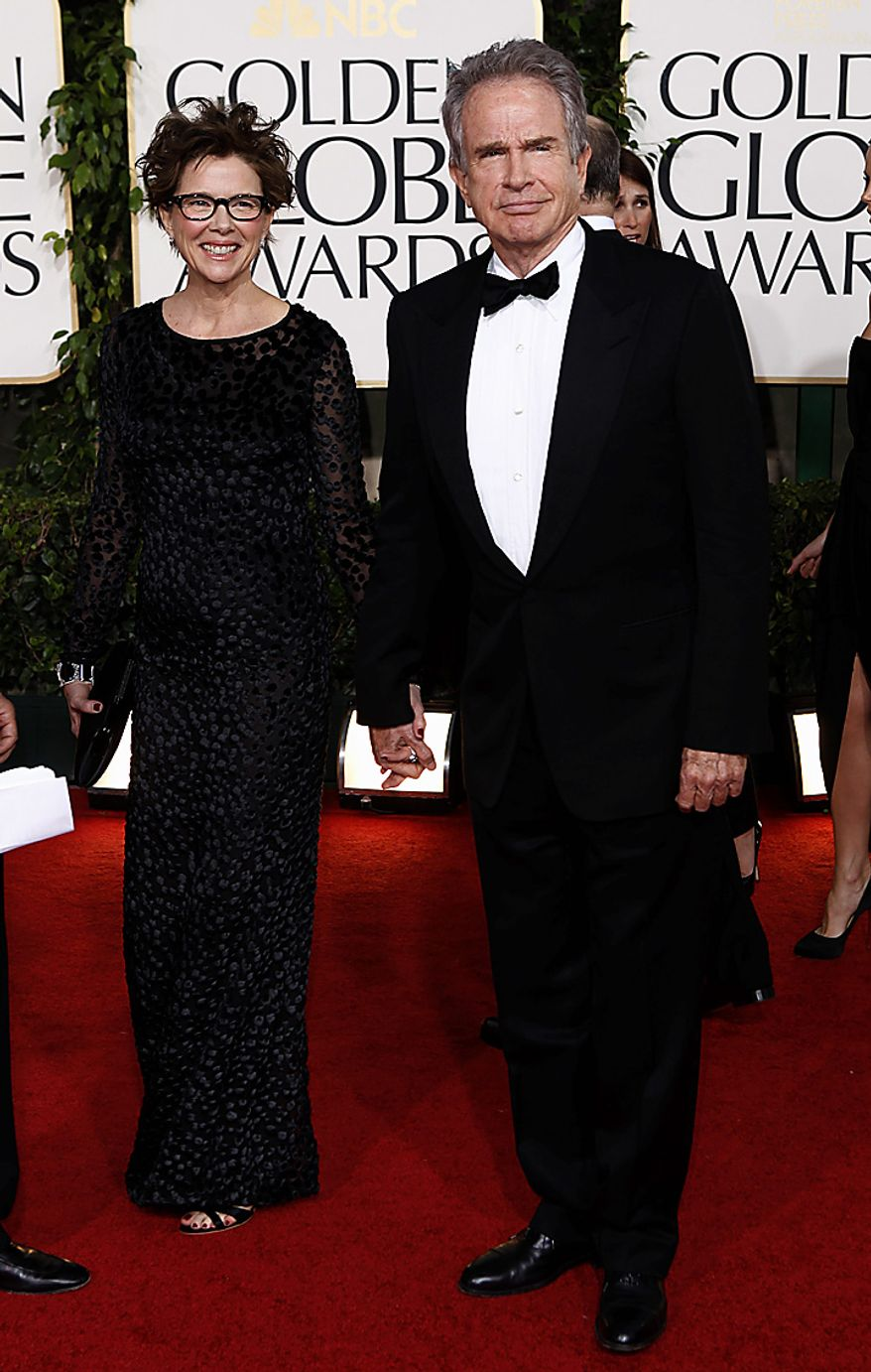 Actors Annette Bening and Warren Beatty arrive at the Golden Globe Awards Sunday, Jan. 16, 2011, in Beverly Hills, Calif. (AP Photo/Matt Sayles)