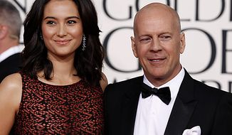 ** FILE ** Bruce Willis arrives with his wife Emma Heming for the Golden Globe Awards Sunday, Jan. 16, 2011, in Beverly Hills, Calif. (AP Photo/Matt Sayles)