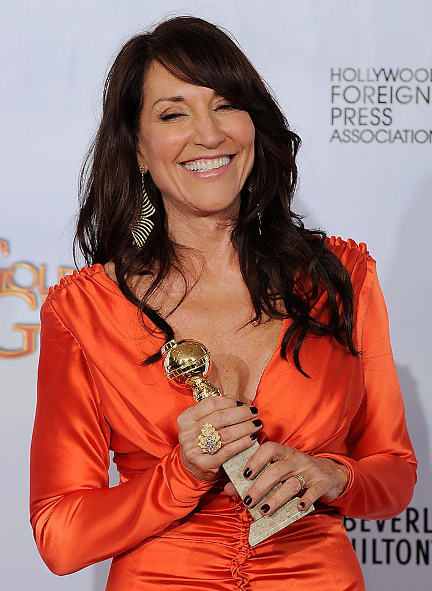 "Katey Sagal holds up her award that she won for Best Performance by an Actress in a Television Series - Drama for her role in ""Sons of Anarchy,"" at the Golden Globe Awards Sunday, Jan. 16, 2011, in Beverly Hills, Calif. (AP Photo/Matt Sayles)"