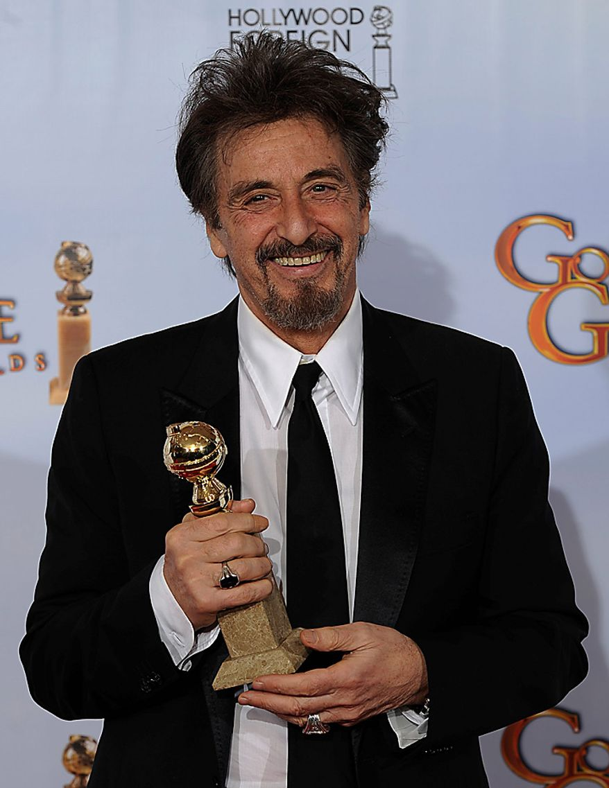 """Al Pacino holds up his award for Best Performance by and Actor in a Mini-Series or Motion Picture Made for Television for his role in """"You Don't Know Jack,""""  at the Golden Globe Awards Sunday, Jan. 16, 2011, in Beverly Hills, Calif. (AP Photo/Matt J. Terrill)"""
