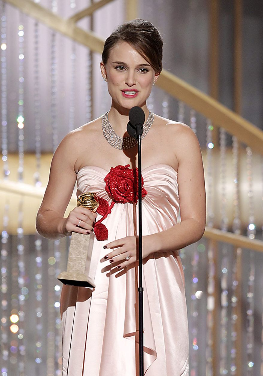 "Natalie Portman accepts the award for Best Actress in a Motion Picture Drama for her role in ""Black Swan""during the Golden Globe Awards, Sunday, Jan. 16, 2011 in Beverly Hills, Calif. (AP Photo/NBC, Paul Drinkwater)"