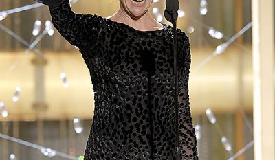 """Actress Annette Bening accepts the award for Best Actress in a Motion Picture Comedy or Musical for her role in """"The Kids Are All Right,"""" during the Golden Globe Awards, Sunday, Jan. 16, 2011 in Beverly Hills, Calif. (AP Photo/NBC, Paul Drinkwater)"""