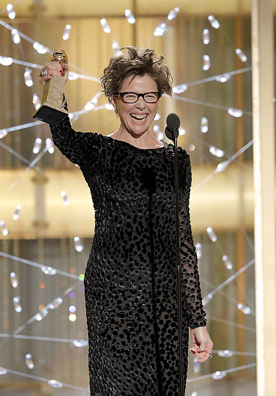 "Actress Annette Bening accepts the award for Best Actress in a Motion Picture Comedy or Musical for her role in ""The Kids Are All Right,"" during the Golden Globe Awards, Sunday, Jan. 16, 2011 in Beverly Hills, Calif. (AP Photo/NBC, Paul Drinkwater)"