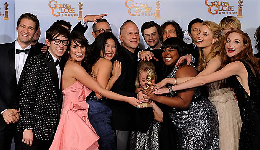 """The cast and crew of """"Glee,"""" pose with the award they won for Best Television Series - Comedy Or Musical at the Golden Globe Awards Sunday, Jan. 16, 2011, in Beverly Hills, Calif. (AP Photo/Matt J. Terrill)"""
