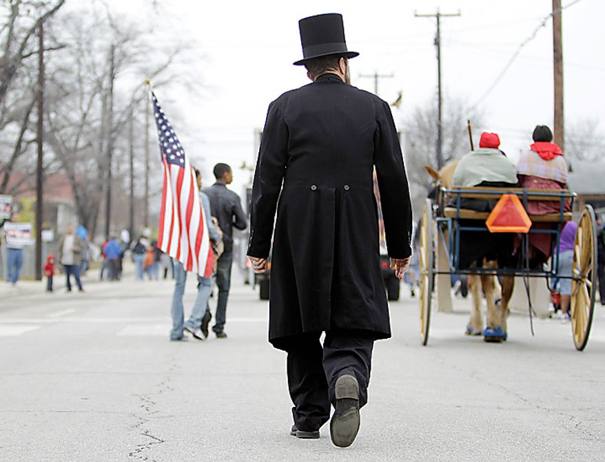 A man dressed as Abraham Lincoln takes part in the Martin Luther King Jr. Day march in San Antonio on Monday, Jan. 17, 2011. (AP Photo/Eric Gay)