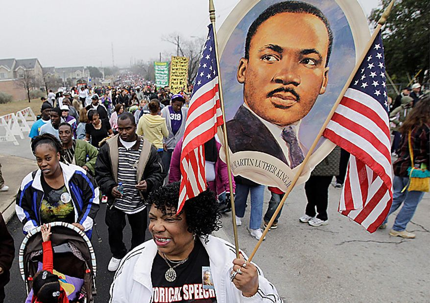 Thousands of people take part in the Martin Luther King Jr. Day march in San Antonio on Monday, Jan. 17, 2011. (AP Photo/Eric Gay)