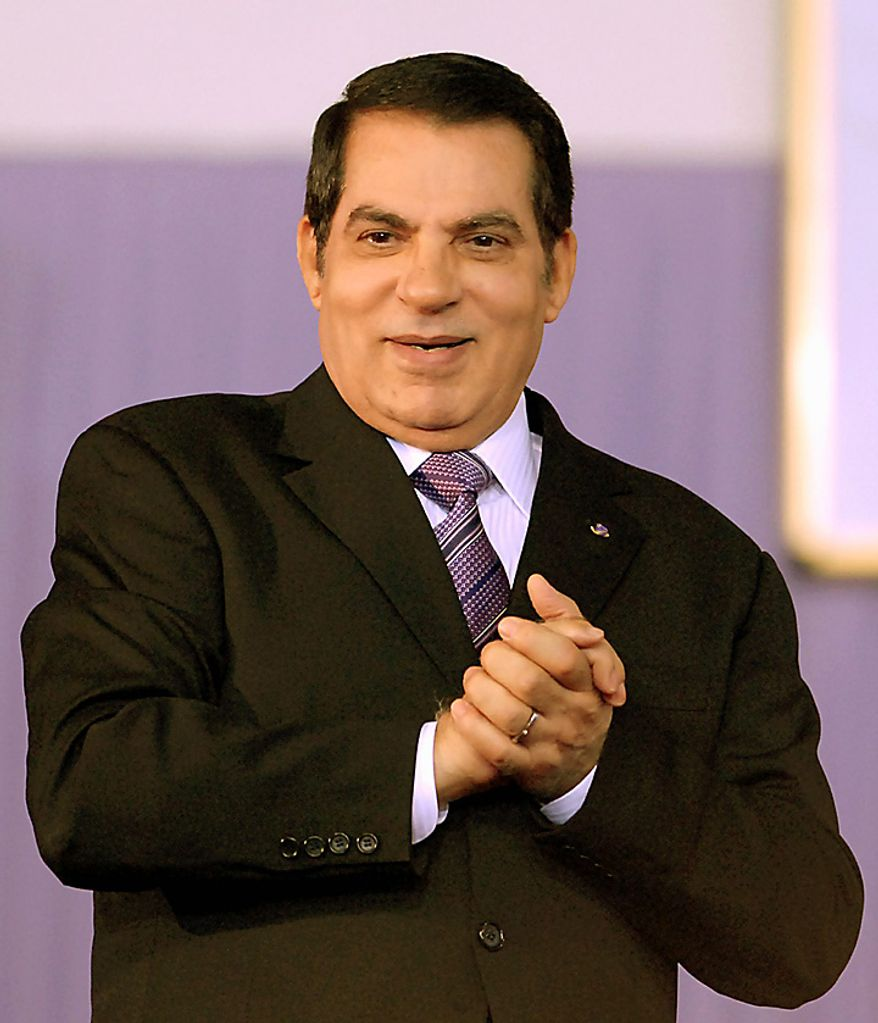 In this Nov. 7, 2008 file photo, Tunisian President Zine El Abidine Ben Ali joins his hands during a meeting marking the 21st anniversary of his ascent to power in Tunis. Ben Ali declared a state of emergency Friday, Jan. 14, 2011 and announced that he would fire his government as thousands of protesters mobbed the capital to demand his ouster. Tunisian air space was closed, gunfire rang out in Tunis, and police beat any protesters they could grab. Prime Minister Mohammed Ghannouchi has gone on state television to say he is assuming power in Tunisia. (AP Photo/dapd, Hassene Dridi, File)
