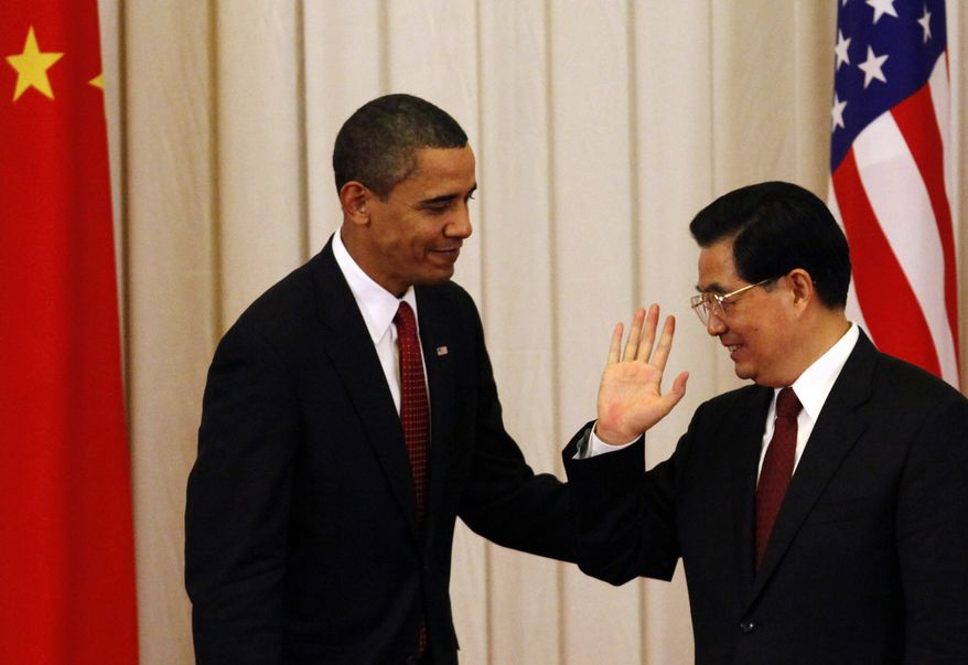 ** FILE ** In this Tuesday, Nov. 17, 2009, file photo, Chinese President Hu Jintao, right, gestures to U.S. President Barack Obama after a joint press conference where both read prepared statements and did not take any questions at the Great Hall of the People in Beijing, China. (AP Photo/Ng Han Guan, File)