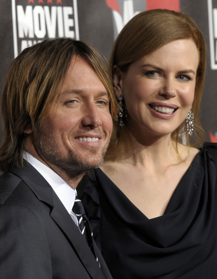 ** FILE ** In this Jan. 14, 2011, file photo, Nicole Kidman, right, and Keith Urban arrive at the 16th Annual Critics' Choice Movie Awards in Los Angeles. The couple on Monday, Jan. 17, announced the arrival of their second daughter, Faith Margaret Kidman Urban, born on Dec. 28 at a Nashville, Tenn., hospital. (AP Photo/Dan Steinberg, File)