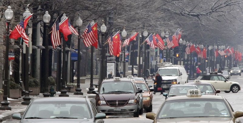 Chinese and U.S. flags were displayed Tuesday along Pennsylvania Avenue in Washington ahead of the arrival of Chinese President Hu Jintao for a state visit hosted by President Obama. (Associated Press)