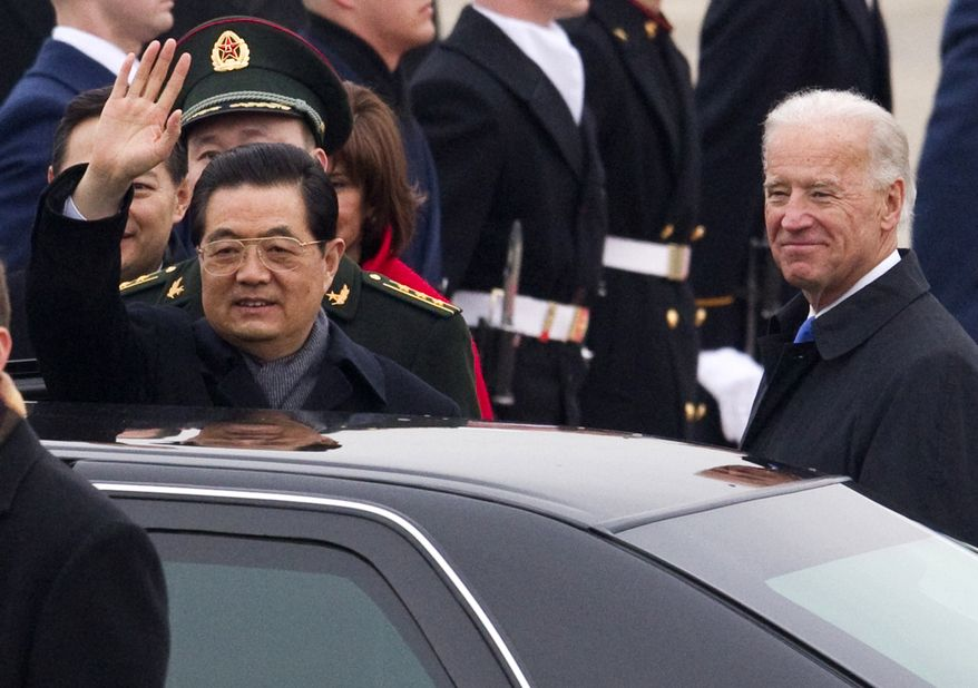 Chinese President Hu Jintao, accompanied Vice President Biden, waves Tuesday during an arrival ceremony at Andrews Air Force Base, Md. (Associated Press)