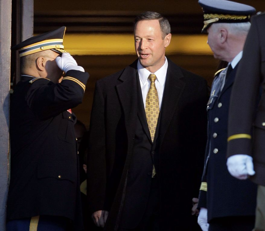 Maryland Gov. Martin O'Malley is saluted before attending inauguration ceremonies outside the Maryland State House in Annapolis, Md, on Wednesday. Mr. O'Malley was sworn in for a second term in office. He focused on economic matters during an 11-minute inauguration speech. (Associated Press)