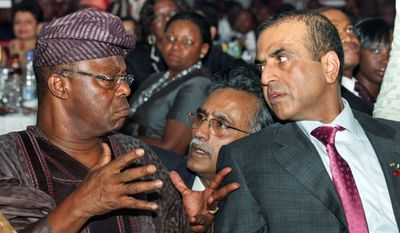The chairman of Zain Nigeria, Oba Otudeko (left), talks with Sunil Mittal, founder and chairman of Bharti Airtel, India's largest mobile-phone company, and Nigeria managing director Rajan Swaroop (center) during the company rebranding in Lagos, Nigeria. (Associated Press)