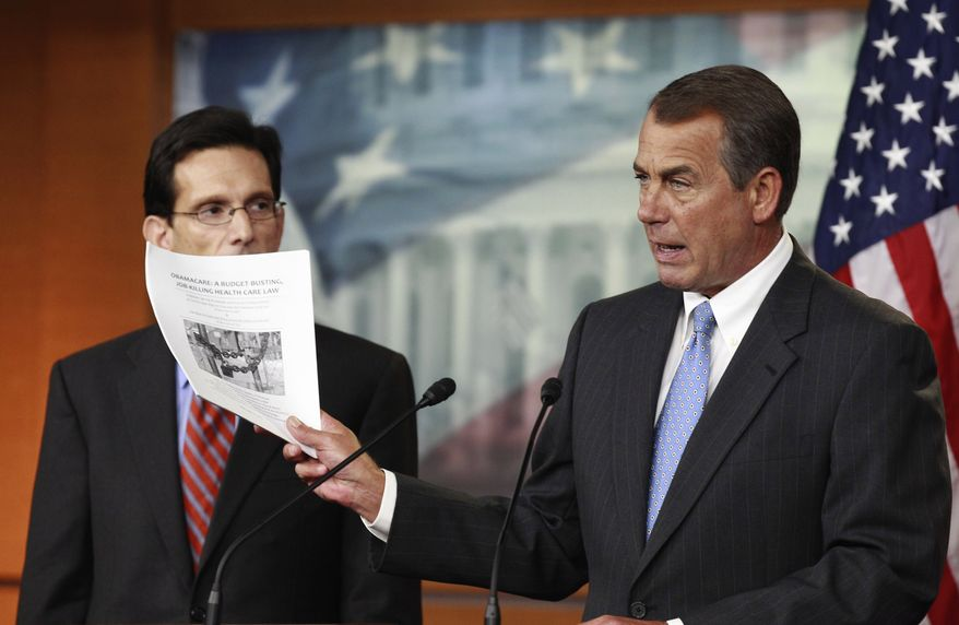 **FILE** In this Jan. 6 photo, House Speaker John Boehner of Ohio (right), accompanied by House Majority Leader Eric Cantor of Virginia, holds a copy of a proposal to repeal the Health Care Bill during a news conference on Capitol Hill. (Associated Press)
