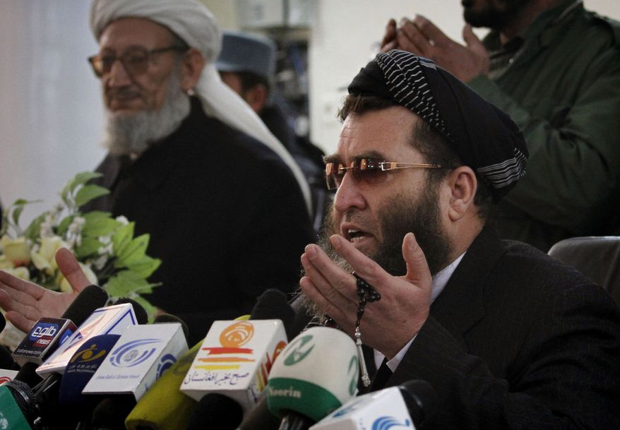 Sedaqalluh Haqiq, who heads a tribunal set up by Afghanistan's Supreme Court, prays at the end of a press event in Kabul, Afghanistan, on Wednesday, Jan. 19, 2011. The tribunal called Wednesday for a one-month delay in the opening of the parliamentary session to further investigate charges of electoral fraud. (AP Photo/Musadeq Sadeq)