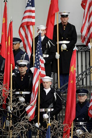 An honor guard stands at attention before a state arrival ceremony for Chinese President Hu Jintao, Wednesday, Jan. 19, 2011, on the South Law