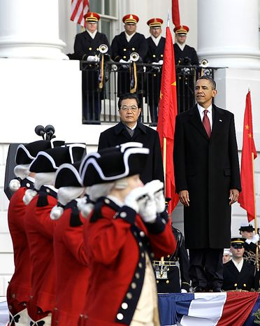 President Barack Obama and China's President Hu Jintao during a state arrival ceremony, Wednesday, Jan. 19, 2011, on the South Lawn of the White House in Washington. (AP Photo/Charles Dharapak)