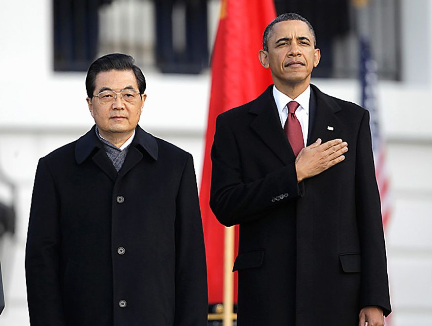 President Barack Obama and China's President Hu Jintao, during a state arrival ceremony on the South Lawn of the White House in Washington, Wednesday, Jan. 19, 2011. (AP Photo/Charles Dharapak)