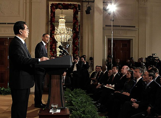 President Barack Obama and China's President Hu Jintao take part in a joint news conference, Wednesday, Jan. 19, 2011, in the East Room of the White House in Washington. (AP Photo/J. Scott Applewhite)
