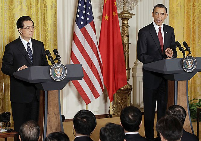 President Barack Obama makes opening remarks during joint news conference with China's President Hu Jintao, Wednesday, Jan. 19, 2011, in the East