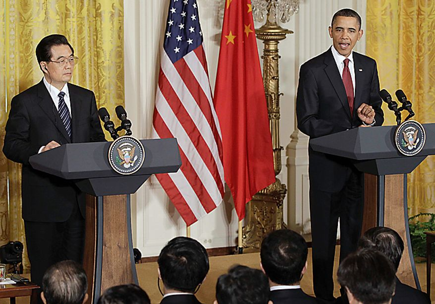 President Barack Obama makes opening remarks during joint news conference with China's President Hu Jintao, Wednesday, Jan. 19, 2011, in the East Room of the White House in Washington.  (AP Photo/Charles Dharapak)