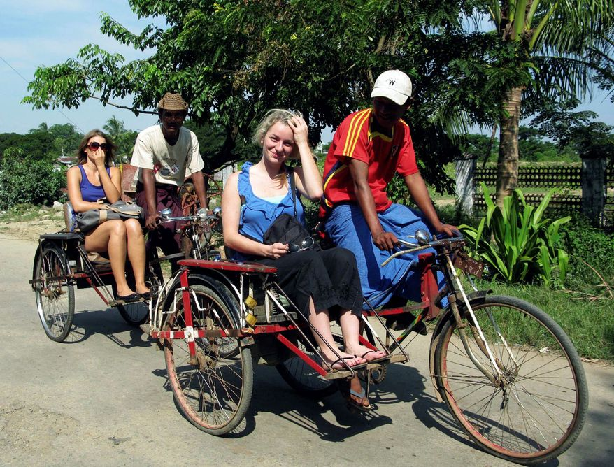 Tourists take cycle rickshaws as they visit Dala township in Yangon, Myanmar. The release of pro-democracy leader Aung San Suu Kyi from house arrest in November appears to be opening the way for more tourists by easing concerns that visiting the country is a signal of support for Myanmar's military dictatorship. (Associated Press)