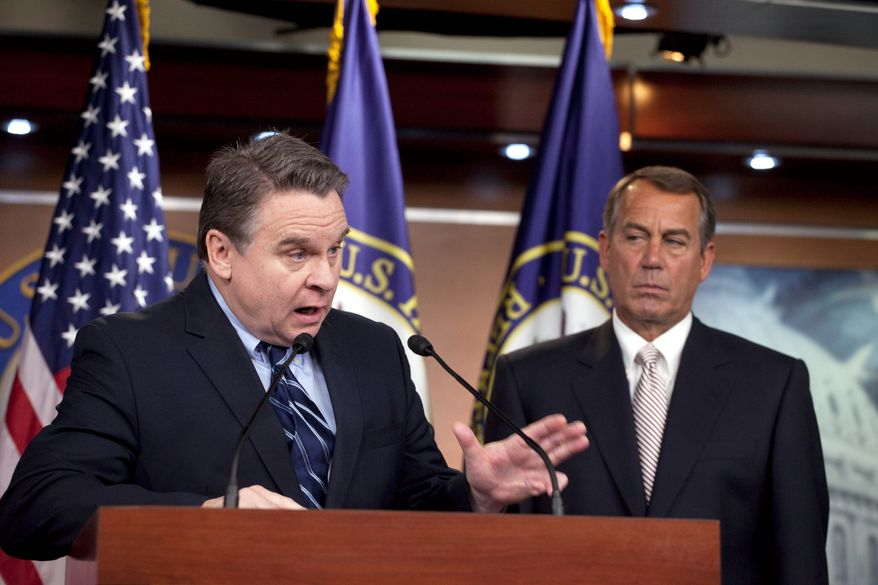 Rep. Christopher H. Smith, New Jersey Republican, speaks at a news conference discussing the introduction of a bill that would ban federal funding of abortions. House Speaker John A. Boehner looks on. (Associated Press)