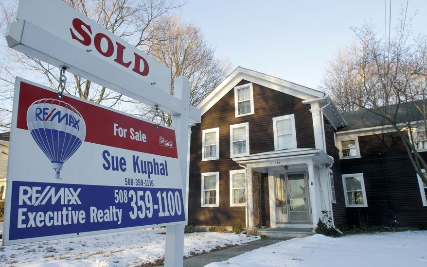 In this photo taken Jan. 10, 2011, a sold sign is seen in front of a home, in Millis, Mass. Sales of previously owned homes dropped to the lowest level in 13 years in 2010 even though sales in December jumped to the fastest pace in seven months.(AP Photo/Steven Senne)
