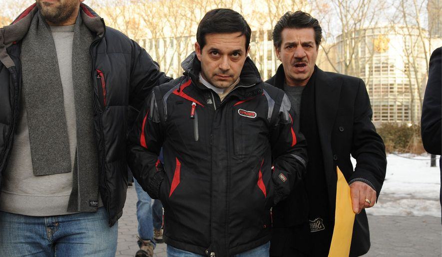 Angelo Spata (center) leaves Brooklyn federal court after posting bail Thursday in New York. Mr. Spata, accused of being an associate of the Colombo crime family, was arrested Thursday in one of the biggest Mafia takedowns in FBI history. (Associated Press)