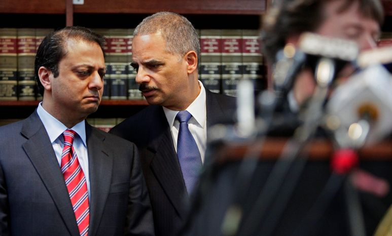 Attorney General Eric H. Holder Jr. (right) and Preet Bharara, U.S. attorney for New York's Southern District. (Associated Press File)