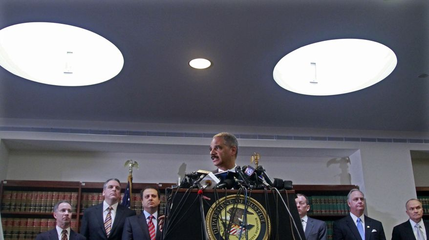 U.S. Attorney General Eric H. Holder Jr., center, surrounded by federal and local law officials, announces organized crime arrests Thursday, Jan. 20, 2011 in New York. More than 120 organized crime associates were arrested Thursday on charges including murder, extortion and narcotics trafficking in one of the largest Mafia crackdowns in FBI history. (AP Photo/Bebeto Matthews)