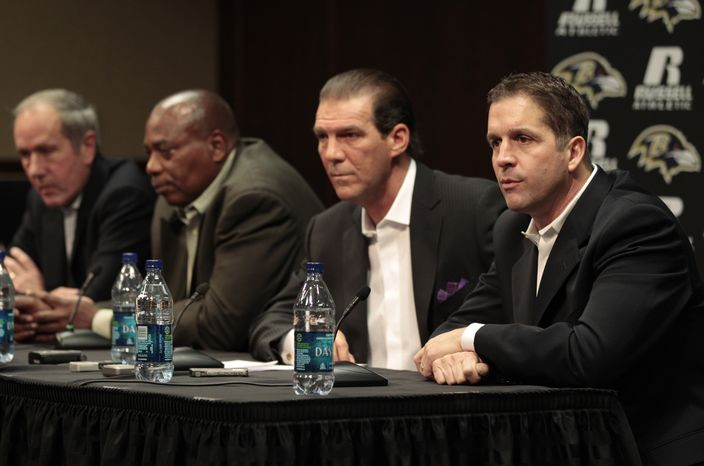 Baltimore Ravens president Dick Cass, far left, general manager and executive vice president Ozzie Newsome, and owner Steve Bisciotti, listen as head coach John Harbaugh, far right, responds to a question during the football teams season review news conference, Thursday, Jan. 20, 2011, in Owings Mills, Md. (AP Photo/Rob Carr)