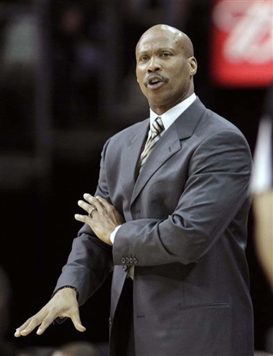 Cleveland Cavaliers head coach Byron Scott reacts in the second quarter in an NBA basketball game against the Phoenix Suns Wednesday, Jan. 19, 2011, in Cleveland. The Suns won 106-98. (AP Photo/Tony Dejak)