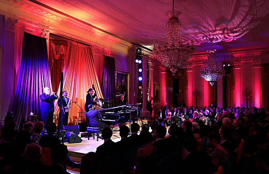 Musician Herbie Hancock performs at the piano at the White House in Washington, Wednesday, Jan. 19, 2011, for President Barack Obama, first lady Michelle Obama, China's President Hu Jintao, and guests, during a State Visit.  (AP Photo/Carolyn Kaster)