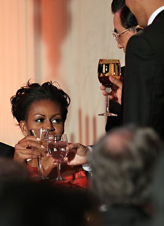 President Barack Obama and China's President Hu Jintao, both standing, and first lady Michelle Obama toast during a State Dinner, Wednesday, Jan. 19, 2011, in the State Dining Room of the White House in Washington. (AP Photo/Carolyn Kaster)