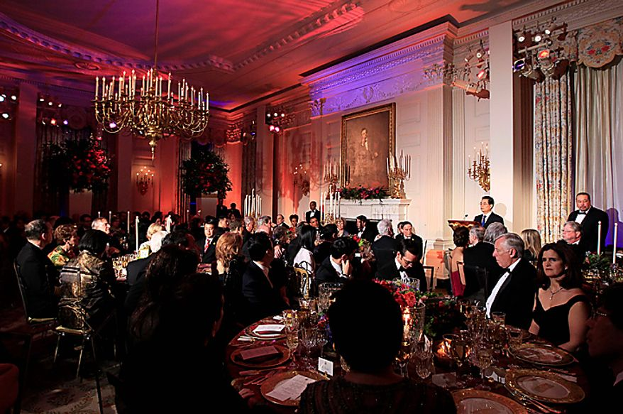 China's President Hu Jintao speaks before offering a toast during a State Dinner hosted by President Barack Obama and first lady Michelle Obama, Wednesday, Jan. 19, 2011, in the State Dining Room of the White House in Washington. (AP Photo/Carolyn Kaster)