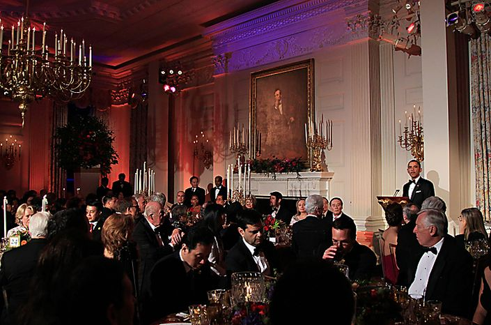 President Barack Obama speaks before he offers a toast as he and first lady Michelle Obama host China's President Hu Jintao State Dinner, Wednesday, Jan. 19, 2011, in the State Dining Room at the White House in Washington. (AP Photo/Carolyn Kaster)