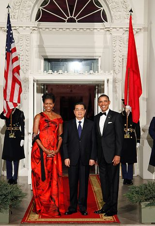 President Barack Obama and first lady Michelle Obama pose with China's President Hu Jintao  at the North Portico of the White House in Washington, Wednesday, Jan. 19, 2011. (AP Photo/Pablo Martinez Monsivais)