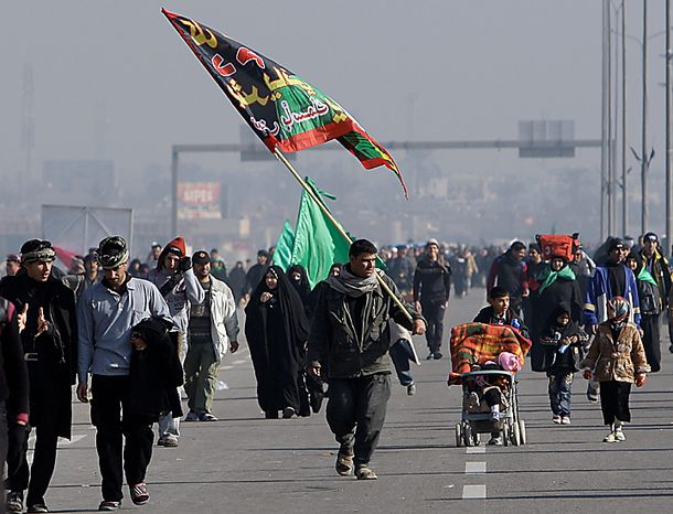 Shi'ite pilgrims march on their way to Karbala for Arbaeen, in Baghdad, Iraq, Thursday, Jan. 20, 2011. The holiday marks the end of the forty-day mourning period after the anniversary of the 7t
