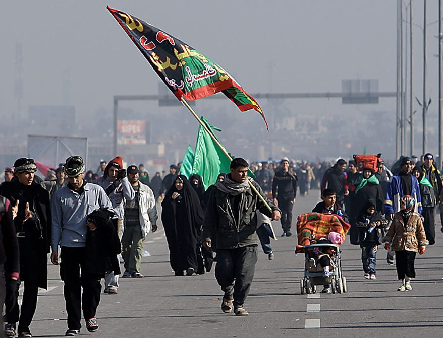 Shi'ite pilgrims march on their way to Karbala for Arbaeen, in Baghdad, Iraq, Thursday, Jan. 20, 2011. The holiday marks the end of the forty-day mourning period after the anniversary of the 7th century martyrdom of Imam Hussein, the Prophet Muhammad's grandson. (AP Photo/Khalid Mohammed)