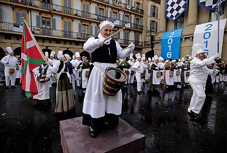 Several Tamborilleros wearing the costume of cooks participate in the traditional La Tamborrada during El Dia Grande, the main day of San Sebastian feasts, in the Basque city of San Sebastian, northern Spain, Thursday, Jan. 20, 2011. From midnight to midnight companies of perfectly uniformed marchers parade through the streets of San Sebastian playing drums and barrels in honor of their patron saint. (AP Photo/Alvaro Barrientos)