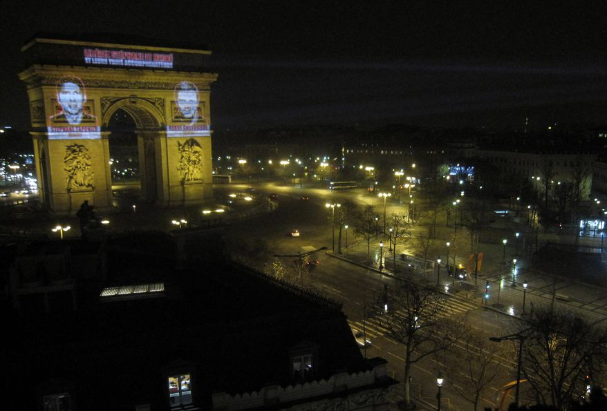 This photo provided by Reporters Without Borders (RSF) shows the portraits of journalists Herve Ghesquiere, right, and Stephane Taponier projected on the Arc de Triomphe in Paris, early Wednesday Dec.29, 2010. The journalists were kidnapped Dec. 30, 2009, east of Kabul. In an audiotape aired by Al Jazeera television on Friday, Jan. 21, 2011, al Qaeda leader Osama bin Laden asked France to withdraw troops from Afghanistan as a condition for the hostages' release. (AP Photo/RSF)