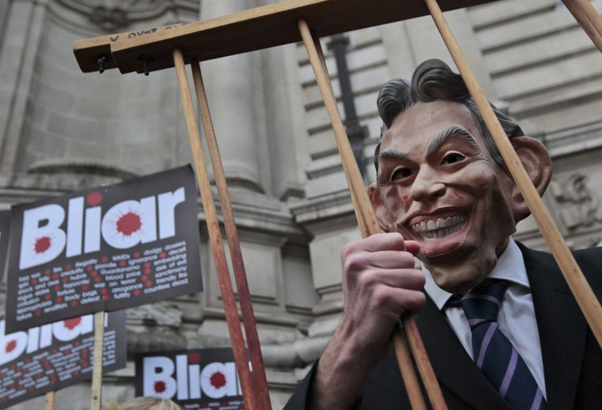 A protester wearing a Tony Blair mask, takes part in a demonstration against the former British prime minister outside the venue of the inquiry into the Iraq war, in London, Friday, Jan. 21, 2011. (AP Photo/Lefteris Pitarakis)